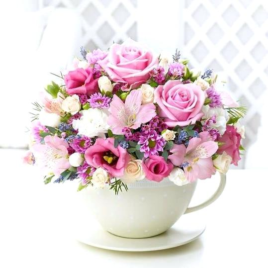 Table Arrangement Of Mix Flowers In A Tea Pot 1